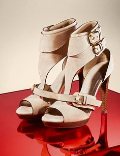 Nubuck leather sandals in nude with distinctive double-buckle cuffs