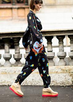 Trending Fashion Style: Jumpsuit. - Coco Rocha in Stella McCartney Resort 2015 robotic manga cartoon characters mask faces pattern print Jumpsuitheading to Stella McCartney Spring Summer 2015fashion show during Paris Fashion Week.
