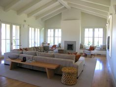 The ceiling, the sectional, the built-ins flanking the fireplace, the windows.  Love the feel of this space.