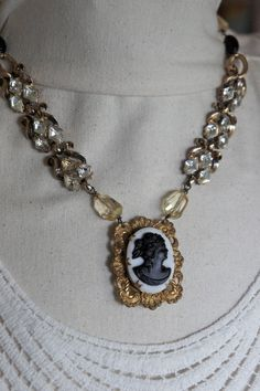 SOLD - Vintage cameo locket assemblage necklace with pearls, gemstones, rhinestones assemblage jewelry - Night In Paris by French Feather Designs..  via Etsy.