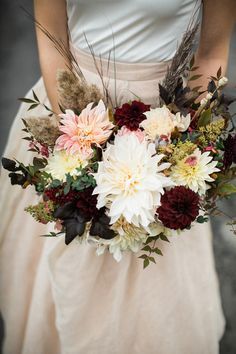 winter wedding bouquet - photo by The More We See http://ruffledblog.com/vintage-pennsylvania-estate-wedding #flowers #bouquets