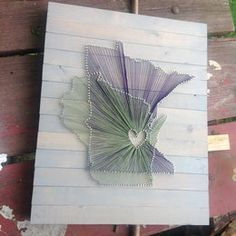 State string art. States are on top of each other with a heart