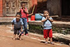 Two nepalese children play with wooden swords in a street of #Bakthapur #Nepal // Due bambini nepalesi giocano con spade di legno in una strada di Bakthapur. #asia #annapurna #reportage #travel #photography #master_shots #ig_nepal #photo #ethnologies #travel #streetphotography #photooftheday #natgeo #natgeotravelpic #natgeocreative #portraits_ig #travelawesome #igtravels - View in HD on www.ethnologies.it