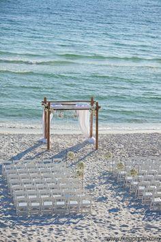 Beach wedding ceremony arbor  Rosemary Beach Wedding   It's a Shore Thing Wedding Planning   Nouveau Flowers