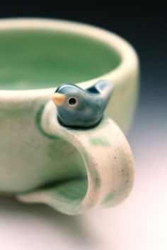Sweet Little Blue Bird on a Pale Green Cup by tashamck on Etsy: Handmade Pottery Bird Cup by Tasha McKelvey: like this to give ideas of somthing students can add to their cup or bowl as ornamental piece. Stoneware Clay, Ceramic Cups, Ceramic Art, Porcelain Ceramics, Pottery Mugs, Ceramic Pottery, Thrown Pottery, Slab Pottery, Pottery Ideas