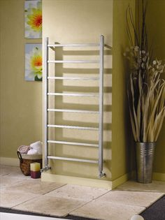 Apollo Genova Straight stainless steel towel warmers brushed stainless steel towel warmer modern minimalist design . Available as electric only or dual fuel (ideal for the summer months when the central heating is off). The Genova straight is suitable for bathrooms and cloakrooms - it comes complete with a 10 year guarantee. Priced at £252.00!