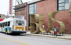 waiting for the BUS inside a giant typographic sculpture by mmmm...