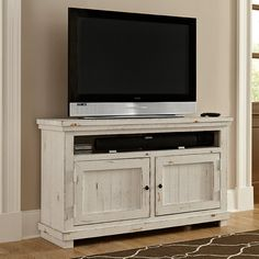 Progressive Furniture Willow TV Console - Stake your claim in reclaimed/distressed style territory with the Progressive Furniture Willow TV Console. The top and sides of this entertainment sta...