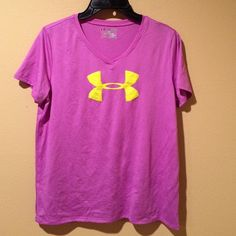 Under Armour loose fit tee Under Armour loose fit v neck tee.  Pre loved.  Worn once.  No rips, tears or stains.  Polyester.  This is a youth XL but fits like a small.  Color is pink/purple with a neon yellow logo. Under Armour Tops