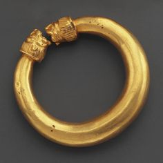 Greek Gold Bracelets with Lion-Head Finials                                                                                                                                                        Culture :                  Classical Greek                                              Period : Classical Period, 4th century B.C.                                          Material : Gold