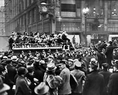 Chicago Christmas 1935: Frantic shoppers on Christmas Eve pause at State and Madison streets to listen to horse-drawn carolers that were making a tour of the Loop.