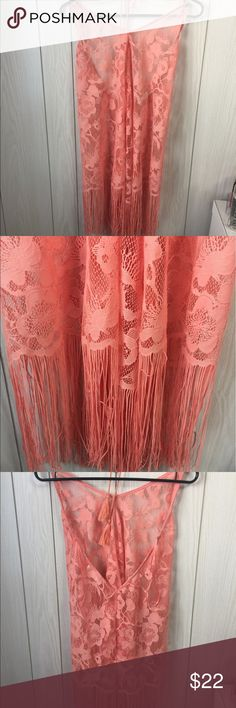NWOT Coral/pink Beach coverup Beautiful coverup that is see through. This ties around the neck and has a long v for the back. This is brand new and I have never worn it Flying Tomato Swim Coverups