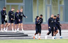 Jesse Lingard Photos - England make their way to the pitch during an England training session at Spartak Zelenogorsk Stadium on June 30, 2018 in Saint Petersburg, Russia. - England Media Access - 2018 FIFA World Cup Russia