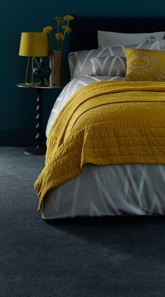 A sumptuous, moody blue, opulent plum or even daring black carpet will complement a palette of fashionable greys. Team with statement accessories in bright, bold colours like mustard yellow and orange tones. Mustard Bedroom, Bedroom Orange, Bedroom Black, Grey And Mustard Bedding, Blue And Gold Bedroom, Mustard Yellow Decor, Blue Bedroom Decor, Ochre Bedroom, Home Bedroom