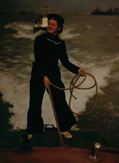 1942 - A member of the Women's Royal Naval Service manning a harbour craft; aiding the war effort during World War Two, December 1942. (Photo by Popperfoto/Getty Images)