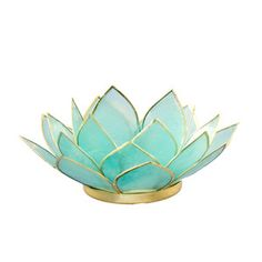 "This handmade tea light holder is designed in the shape of an open lotus flower, with three rings of translucent capiz shell petals. 5"" from tip to tip, 2"" high. Shell edges and bases are silver, givi"