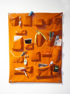 megan whitmarsh: #orange soft wall organizer #art #home