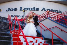 Smiling bride and groom on steps of Joe Louis Arena #Michiganwedding #Chicagowedding #MikeStaffProductions #wedding #reception #weddingphotography #weddingdj #weddingvideography #wedding #photos #wedding #pictures #ideas #planning #DJ #photography #bride #groom