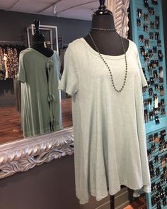 Super cute top!! And look at the back   Also that necklace is 50% off!!