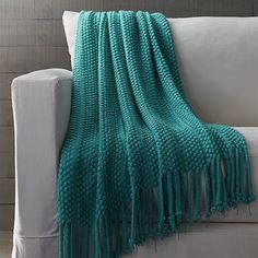 Soft puffs billow in rows in a textured, lightweight, contemporary weave, finished with casual dreadlock fringe, in a classic look gone global. A grace note of visual interest and pure color draped over favorite chair or foot of the bed.