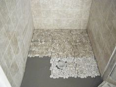 Pebble Tile Shower Ideas | Outside the local Power Co. puts in a new transformer with underground ...