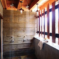 Bathing outdoors is the height of mountain living, especially when done in a rugged style. With its rough natural textures in concrete and stone, this two-person outdoor shower, tucked under the overhang off the master bedroom, provides a thoroughly invigorating alpine experience.