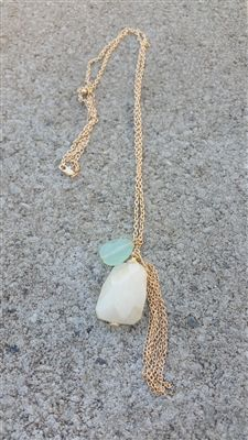 Mint Stone and tassel long necklace. http://www.shoplauramichelle.net/product-p/zf-33321bei.htm