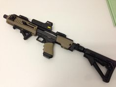 It's a glock with a kit on it Rifles, Airsoft, Revolver, Future Weapons, Assault Weapon, Military Guns, Cool Guns, Tactical Gear, Tactical Pistol