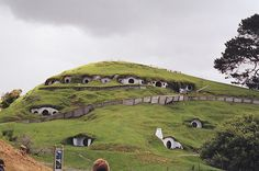 """A thing to do in New Zealand is to stay in an authentic hobbit hole for at least one night. This is the only remaining sets of hobbit holes from the """"Lords Of The Rings"""" movie.     Photo of Hobbit Holes by KiwiHugger, via Flickr"""