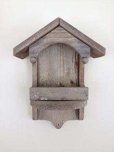 Antique wooden bird feeder