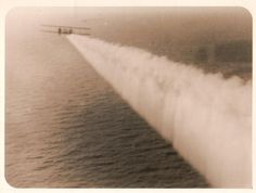 Vintage anonymous studio photograph showing an airplane after take off from the ocean liner Ile de France. - Size (inches): 7,7x10 - Date: ca 1930 - Location: Atlantic Ocean - Condition: Silver print, good to very good condition, light creases - Sellers reference: G03388