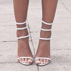 White elegant heeled sandals, summer shoes ideas.