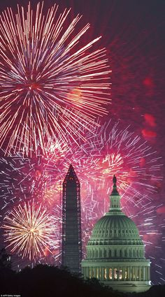 Fourth of July US Independence Day fireworks are seen over the US Capitol Building and the Washington Monument.