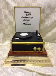 Album - Google+ Golden wedding anniversary 1950s record player cake in a black and gold theme.. In chocolate cake with buttercream and ganache filling all hand decorated and airbrushed !!!