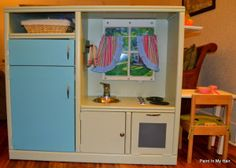 old entertainment center turned play kitchen - too cute!