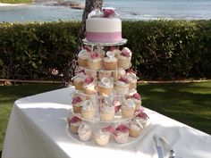 A Cupcake Wedding Cake Tower for our wedding couple at Paradise Cove following their ceremony. Wedding planning by Tori Rogers, www.hawaiianweddings.net