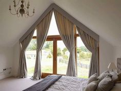 4m high apex window with angled, interlined curtains behind pelmets for  one of our trade clients and her client in Shaftesbury. www.hampshirecurtainmakers.co.uk