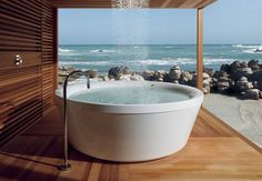 At first glance you might think it's a back to basics outdoor tub with it's simple tap ~ but imagine lying in the tub with the overhead shower raining down while taking in the surrounding veiws ~ can it get any better??  ♥