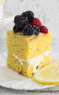 This MOIST LEMON CAKE recipe with lemon curd and seven minute frosting is perfect  for Summer. This lemon layer cake is made from scratch and bursting with zesty lemon flavors. From cakewhiz.com