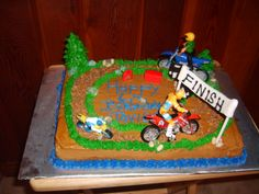 Dirt Bike cake for nephews birthday. Cake is yellow cake with buttercreme icing and dirt bikes are toys Fifth Birthday Cake, Bike Birthday Parties, Dirt Bike Birthday, Birthday Ideas, Dirt Bike Cakes, Dirt Cake, Bicycle Cake, Birthday Cake Pictures