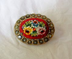 Vintage Italian Millefiori Mosaic Brooch with Brass Mounting. $16.00, via Etsy.