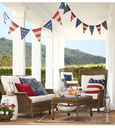 Dream Porch! Look at the details! via @Pottery Barn   Fourth of July | 4th of July | beautiful porch | vacation home | July 4th Party | July 4th Decorations