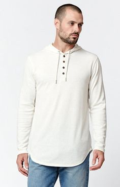 This On The Byas cold-weather essential boasts a cool, crisp, laid-back look. TheRiley Hooded Long Sleeve T-Shirt features long sleeves, a 4 button neck, and an adjustable drawstring hood.   Oatmeal long sleeve tee Four-button neck Adjustable drawstring hood Long sleeves Round hem Machine washable