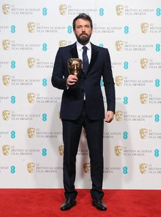 Ben Affleck with the BAFTA for Best Film. This is a sharp suit, sleek hair, and very manly stance. Everyman at his finest. British Academy Film Awards, Best Director, Sleek Hairstyles, Ben Affleck, Award Winner, Facial Hair, Creative Inspiration, Nice Dresses, Man Hair