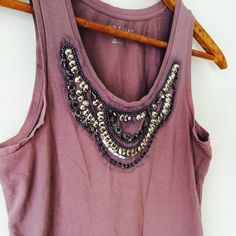 Purple Sequin Tank This top is gorgeous. It has a razor back and a beautiful neckline. The color is a subdued purple. More of a maroon. In very good condition! Ann Taylor Tops Tank Tops