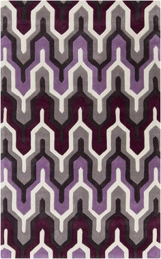 Orchid and plum shine in this graphic geometric rug with hand carved details. From the Cosmopolitan Collection by Surya. (COS-9178)