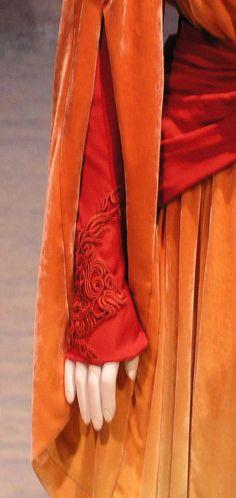 Sleeve detail orange hand maiden dress