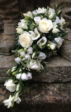 Teardrop/Cascade Wedding Bouquet Which Includes: Ivory Roses, White Lisianthus + Buds, White Freesia & Greenery + Foliage