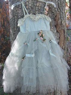 Vintage 1950's Child's Party Dress Fairy: Gorgeous 1950's vintage child's party dress or fairy godmother costume! (Could adapt somethings for flower girl dress) This dress is made of  sparkly silver tulle, lace & satin ribbon. This would make a lovely fairy costume that no other child would have! It also reminds me of the good witch from the Wizard of Oz. The dress is in good vintage condition except for a large stain on the inside slip that cannot be seen due to flowers being over it.