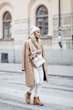 Angelica Blick's timberland outfit consists of beige trousers, a matching knit sweater and a stylish double breasted camel coat; combining multiple in trends.Coat/Trousers: Zara, Knit: Gina Tricot, Boots: Timberland, Bag: Phillip Lim.